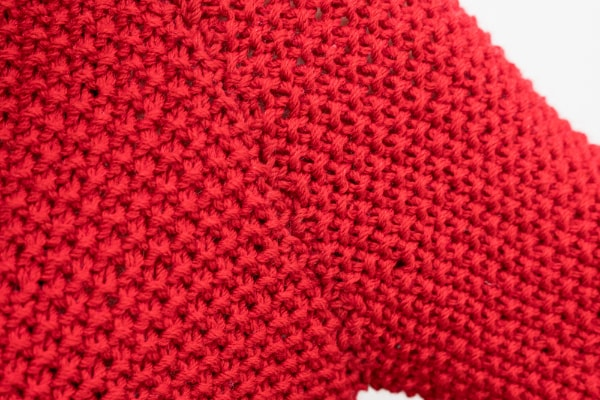 manche tricot rouge